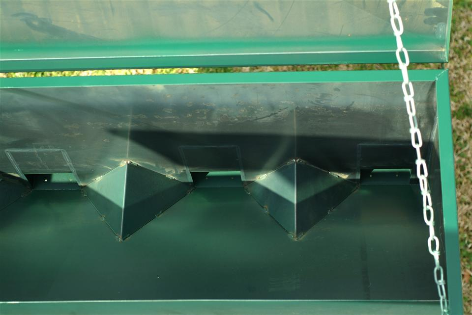 Feed and grain is distributed by baffles and diverters to each individual spout.