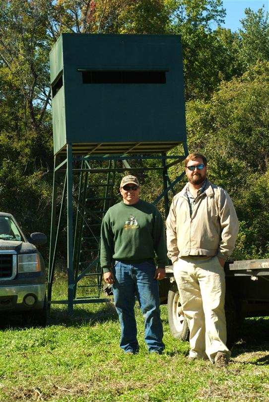 Right: Brian Jones from Tchula, Ms receives his brand new 5'X7' on a 10' tower 3 weeks before rifle season from Steel Outdoors owner Dwayne Mclemore. B promises us photos to come from  this years deer season...